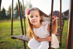 Young happy girl on the swings Stock Photo