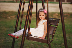 Young happy girl on the swings Royalty Free Stock Photos