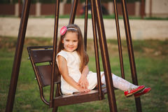 Young happy girl on the swings Royalty Free Stock Photography
