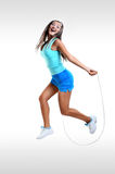 Young Happy Girl training with Jump Rope isolated on White Stock Images