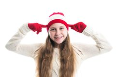 Happiness winter holidays christmas. Teenager concept - smiling young woman in red hat, scarf and over white background. royalty free stock photo
