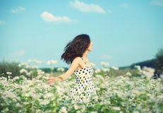 Girl walking on the buckwheat field. Young happy girl walking on the buckwheat field stock image