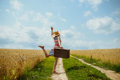 Young happy girl wearing striped dress dancing on Stock Images
