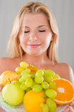 Young Happy Girl With A Plate Of Juicy Fruits Royalty Free Stock Image