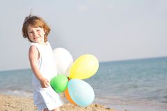 Young Happy Girl With Balloons On Sea Background Stock Image