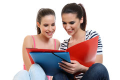 Young happy girlfriends learning together Stock Photos