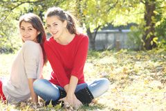 Young happy girls in autumn park outdoor portrait Stock Photos