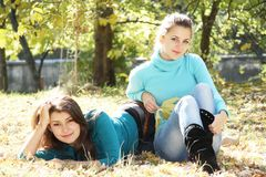 Young happy girls in autumn park outdoor portrait Royalty Free Stock Photo