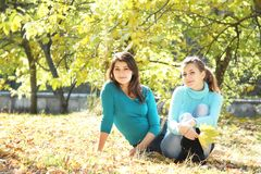 Young happy girls in autumn park outdoor portrait Royalty Free Stock Images