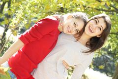 Young happy girls in autumn park outdoor portrait Stock Image