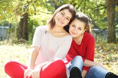 Young happy girls in autumn park outdoor portrait Stock Images