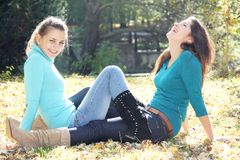 Young happy girls in autumn park outdoor portrait Royalty Free Stock Image