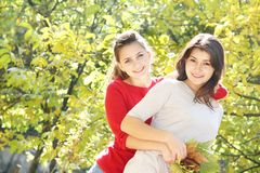 Young happy girls in autumn park outdoor portrait Stock Photography