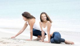 Young happy girls on beach Stock Images