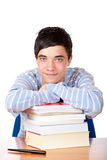 Young happy handsome male student leaning on books. Young happy male student is smiling and leaning on his study books. Isolated on white Stock Photos