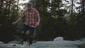 Young happy handsome man hiking alone, walking towards camera out of focus at amazing Yosemite national park slow motion stock video