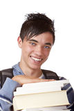 Young, happy, handsome student holding books. Young student holding books and smiles happy into camera. Isolated on white Stock Photos