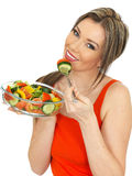 Young Happy healthy Woman Eating a Fresh Mixed Garden Salad Stock Images