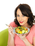 Young Happy Healthy Woman Holding a Plate of Freshly Mixed Salad Stock Photo