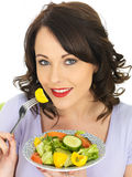 Young Happy Healthy Woman Holding a Plate of Freshly Mixed Salad Stock Photos