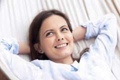 Young happy woman relaxing on hammock dreaming resting in summer royalty free stock photo