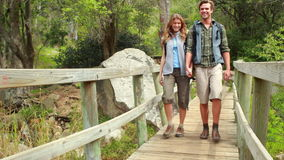 Young happy hiker couple hiking stock footage