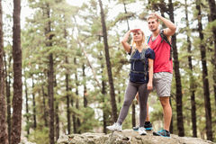Young happy hiker couple looking away Stock Image