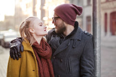 Young happy hipster couple. Young smiling happy hipster couple hugging in winter Royalty Free Stock Photography