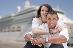Young Happy Hispanic Couple In Front of Cruise Ship Stock Image