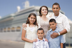 Young Happy Hispanic Family In Front of Cruise Ship Stock Photo