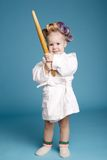 Young happy housewife with rolling pin Royalty Free Stock Photography