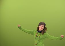 Young happy human. In a green background Royalty Free Stock Photography