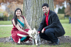 Young Happy Indian Couple Posing With Elephant Royalty Free Stock Photos
