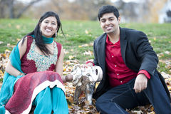 Young Happy Indian Couple Posing With Elephant Royalty Free Stock Image