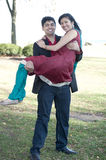 Young Happy Indian Man Carrying His Fiance Royalty Free Stock Photos