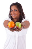 Young happy indian woman holding fruits Royalty Free Stock Photo
