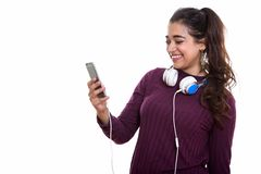 Young happy Indian woman smiling while wearing headphones around royalty free stock photos