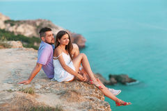 Young happy interracial couple on beach royalty free stock photography