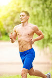 Young and happy jogger Stock Photos