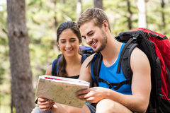Young happy joggers looking at map Stock Photos