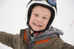 Young happy, jolly boy laughs in helmet, white background Stock Images