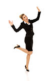 Young happy jumping businesswoman. With hands up Stock Photos