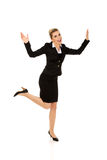 Young happy jumping businesswoman Stock Photo
