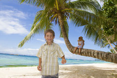 Young Happy Kids - Boy And Girl - On Tropical Beach Backgrou Stock Photo