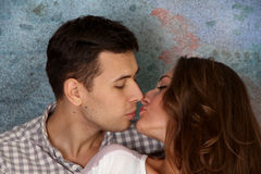 Young happy kissing amorous couple Stock Photo