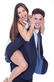 Young happy latin couple playing together Stock Photography