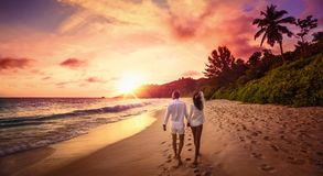 Young Happy Lovers on Beach Sunset stock photography