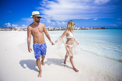Young happy lovers on romantic travel honeymoon having fun on vacation summer holidays romance. Royalty Free Stock Photography