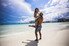 Young happy lovers on romantic travel honeymoon having fun on vacation summer holidays romance. Stock Images