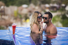Young happy lovers on romantic travel honeymoon having fun on vacation summer holidays romance. Stock Photo